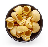 Pasta in bowl  on white, from above Royalty Free Stock Photos