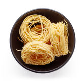 Pasta in bowl  on white, from above Royalty Free Stock Photo
