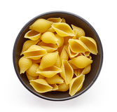 Pasta in bowl  on white, from above Royalty Free Stock Image
