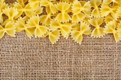 Pasta Bows on Brown Background Royalty Free Stock Photography