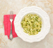 Pasta bows with pesto Stock Images