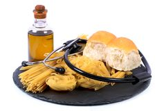 Pasta and bread. Beautiful shot showing wheat pasta with bread loaf Stock Photos