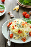 Pasta with brie cheese and roasted tomatoes Royalty Free Stock Photography