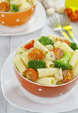 Pasta with broccoli and cherry tomatoes Royalty Free Stock Photography