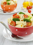 Pasta with broccoli and cherry tomatoes Royalty Free Stock Photos