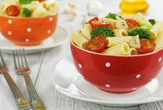 Pasta with broccoli and cherry tomatoes Stock Images