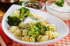Pasta with broccoli and grated cheese. Italian pasta with broccoli and grated parmesan cheese Stock Photography