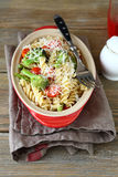 Pasta with broccoli pieces in a dish Stock Images
