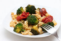 Pasta with broccoli and tomatoes Royalty Free Stock Photos