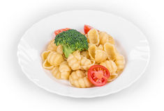 Pasta with broccoli and tomatoes. Royalty Free Stock Photo