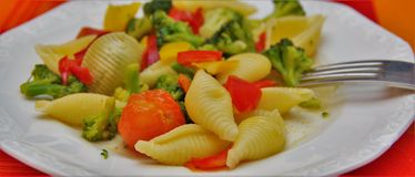 Pasta with broccoli and tomatoes Royalty Free Stock Photography