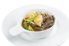 Pasta with broth and meat. Pasta with broth, beef, fried egg and onions Stock Images