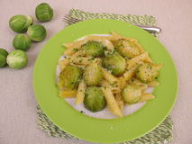 Pasta with brussels sprout from pan Stock Photo