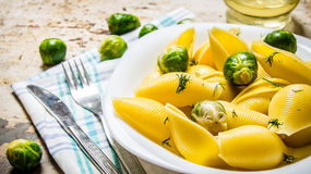Pasta with Brussels sprouts on the fabric. Stock Image