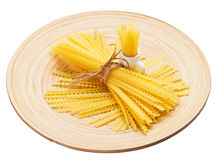 Pasta bunch composition on a wooden plate Royalty Free Stock Photos