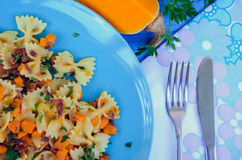 Pasta With Butternut Squash and Prosciutto. Italian Wholemeal Pasta Farfalle Butterfly Bow-tie with Butternut Squash and Prosciutto. Pasta with pumpkin sauce Stock Images