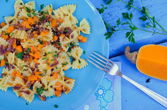 Pasta With Butternut Squash and Prosciutto. Italian Wholemeal Pasta Farfalle Butterfly Bow-tie with Butternut Squash and Prosciutto. Pasta with pumpkin sauce Stock Photos