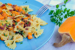 Pasta With Butternut Squash and Prosciutto. Italian Wholemeal Pasta Farfalle with Butternut Squash and Prosciutto. Pasta with pumpkin sauce, bacon and fresh Royalty Free Stock Photo
