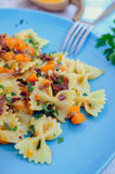 Pasta With Butternut Squash and Prosciutto. Italian Wholemeal Pasta Farfalle with Butternut Squash and Prosciutto. Pasta with pumpkin sauce, bacon and fresh Royalty Free Stock Photography