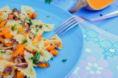 Pasta With Butternut Squash and Prosciutto. Italian Wholemeal Pasta Farfalle with Butternut Squash and Prosciutto. Pasta with pumpkin sauce, bacon and fresh Stock Photos