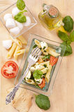 Pasta with caprese salad Royalty Free Stock Photography