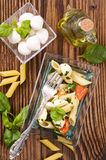 Pasta with caprese salad Stock Photos