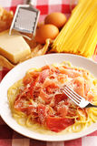 Pasta carbonara. Over red cloth Stock Photography