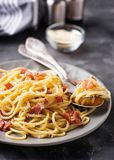 Pasta Carbonara with bacon and parmesan. Selective focus royalty free stock image
