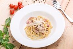 Pasta carbonara with bacon Stock Photos