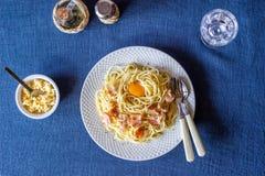Pasta Carbonara on a blue background. Italian food stock photos