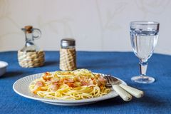 Pasta Carbonara on a blue background. Italian food royalty free stock images