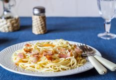 Pasta Carbonara on a blue background. Italian food royalty free stock photos