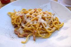 Pasta carbonara. A classic pasta carbonara served outside in restaurant in Lucca, Italy Stock Photos