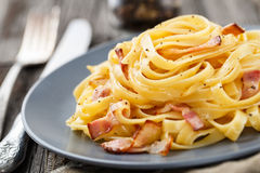 Pasta carbonara. Delicious pasta carbonara on a gray plate Royalty Free Stock Photos