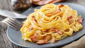 Pasta carbonara. Delicious pasta carbonara on a gray plate Royalty Free Stock Image