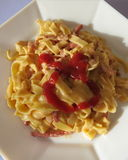 Pasta Carbonara. Dish with fresh pasta, bacon,sauce,cream and tomato Royalty Free Stock Photos