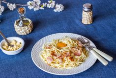Pasta Carbonara. Flowers in the background. Italian food.  stock images