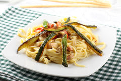 Pasta carbonara with fresh zucchini Stock Photo