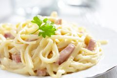Pasta Carbonara with ham and cheese Stock Images