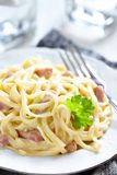 Pasta Carbonara with ham and cheese Royalty Free Stock Photos