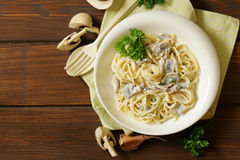 Pasta carbonara with mushrooms, garlic. And parsley Stock Photo