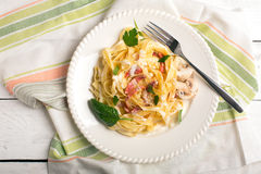 Pasta Carbonara. With pancetta, mushrooms and sauce Stock Photo