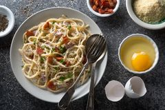 Pasta Carbonara. A plate of delicious pasta carbonara with fettuccine, bacon, parsley, parmesan cheese and egg stock images