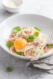 Pasta carbonara with prosciutto,  parmesan cheese and eggs yolk Stock Image
