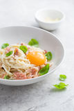 Pasta carbonara with prosciutto,  parmesan cheese and eggs yolk Stock Photography