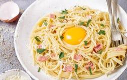 Pasta Carbonara. Spaghetti with bacon, egg, parsley and Parmesan cheese closeup. A traditional Italian dish. Selective focus Stock Photo