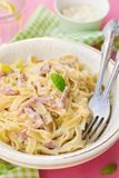 Pasta Carbonara style with bacon, cheese and courgette zucchini stock photography