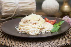 Pasta carbonara, traditional Italian cuisine. Cheese, sauce, cream Royalty Free Stock Photo
