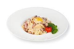 Pasta Carbonara. On white plate with parmesan and yolk Stock Photos