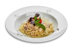 Pasta carbonara on a white plate Stock Images